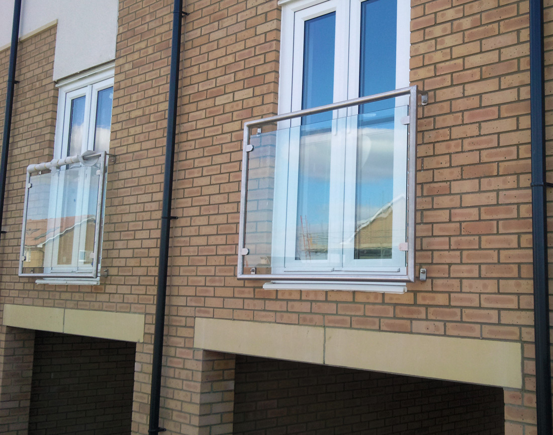 Steel juliet balconies from iron design in west midlands for Balcony with glass