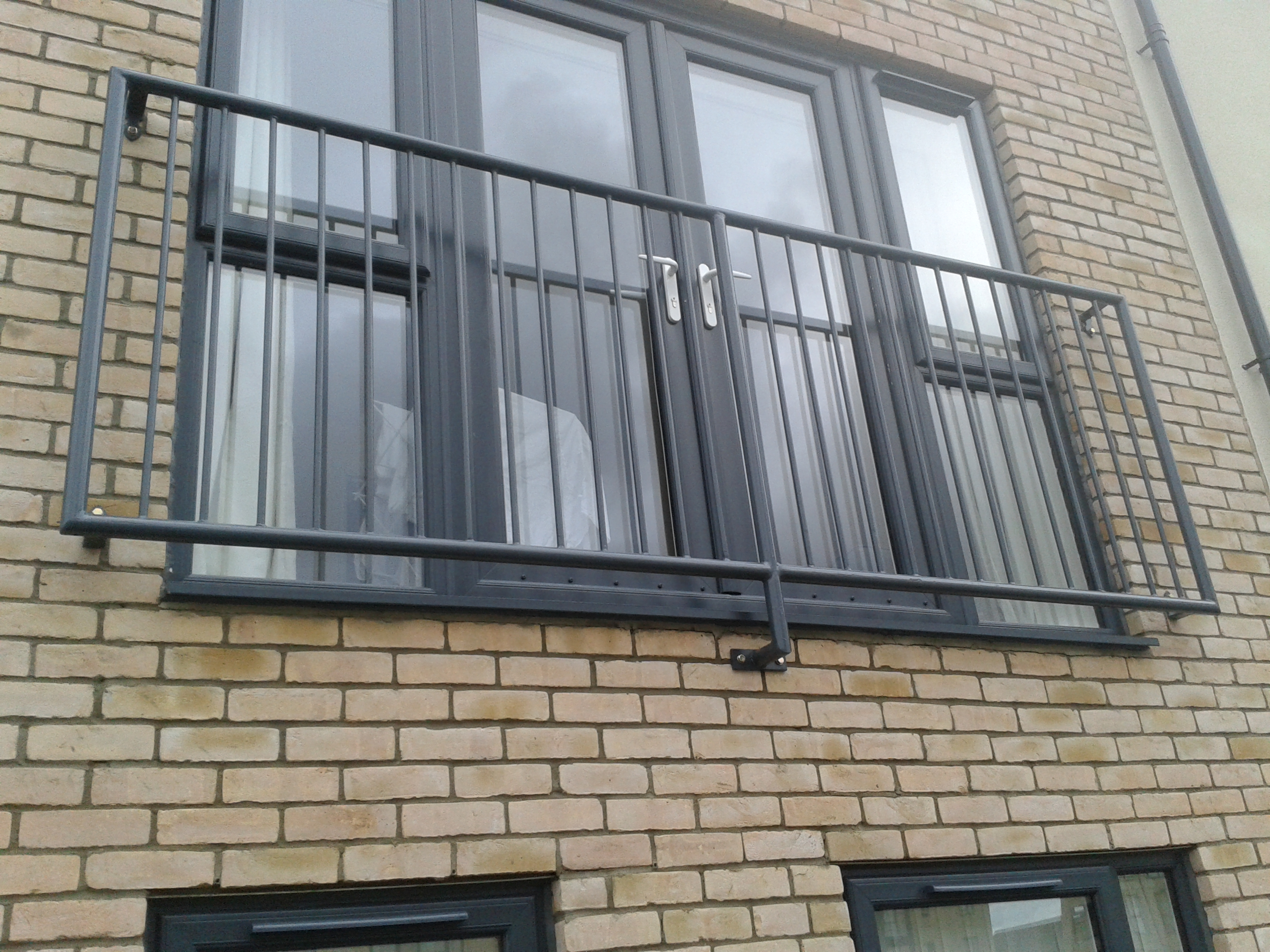 Steel juliet balconies from iron design in west midlands for Steel balcony