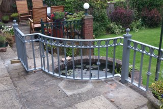 Grey iron railing in Quinton