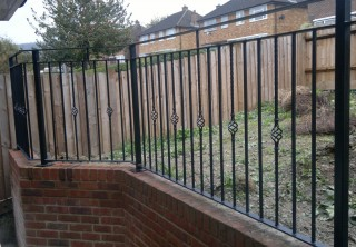 Flat topped iron railings in Walsall