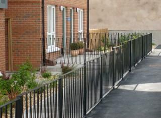 Flat topped iron railings