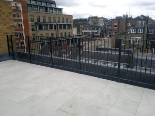 Flat topped iron railings for a rooftop balcony