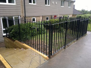 Flat topped iron railings in Peterborough