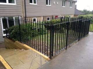 Flat topped iron railings in Peterborough